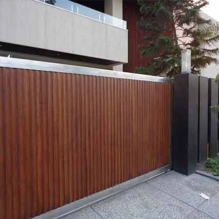 Give your home a stylish look with wooden style main gate for Wooden main gate design